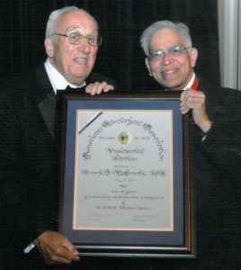 Dr. Datta G. Wagle, 2011 AUA President, presents Frank with the Presidential Citation Award.